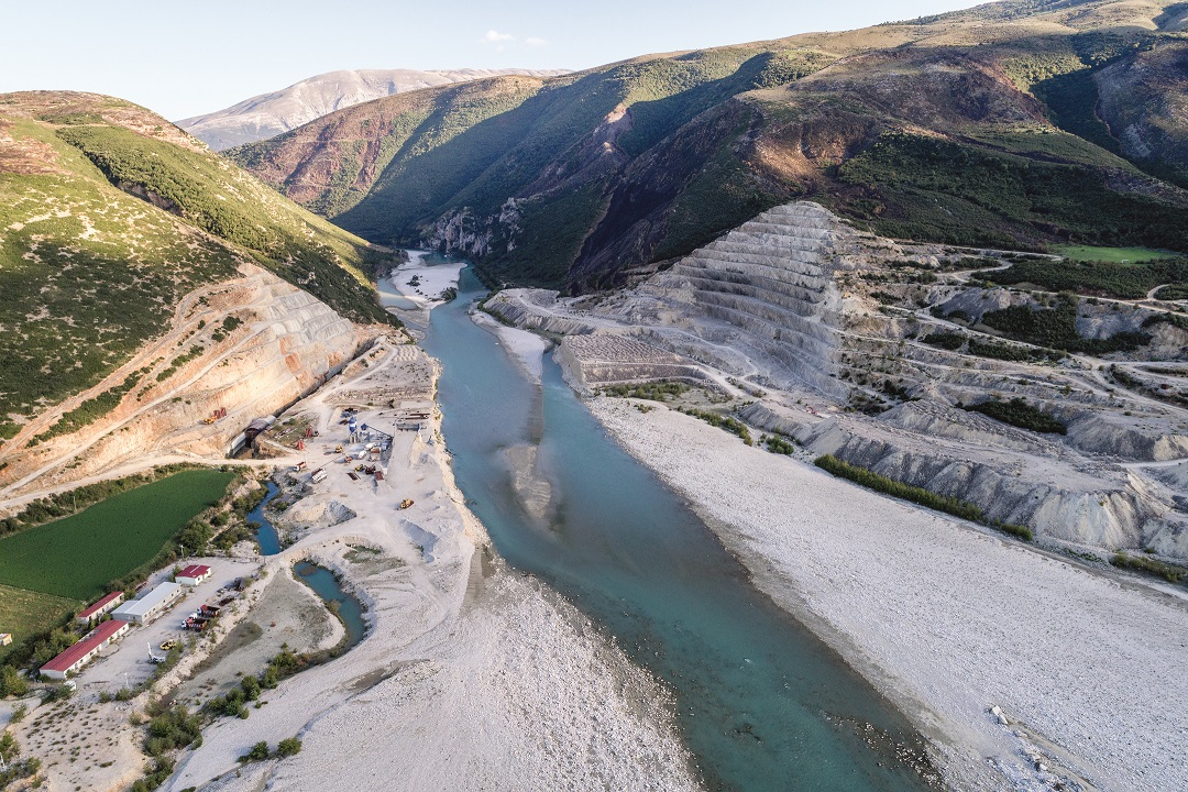 The sleeping giant. The idle Kalivac Dam on the Vjosa River still threatens this wild river and local communities. As of now, the river still fows through it unaffected. © Andrew Burr
