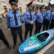 Day 35: Well-guarded kayak at the protest in Tirana © Andrew Burr
